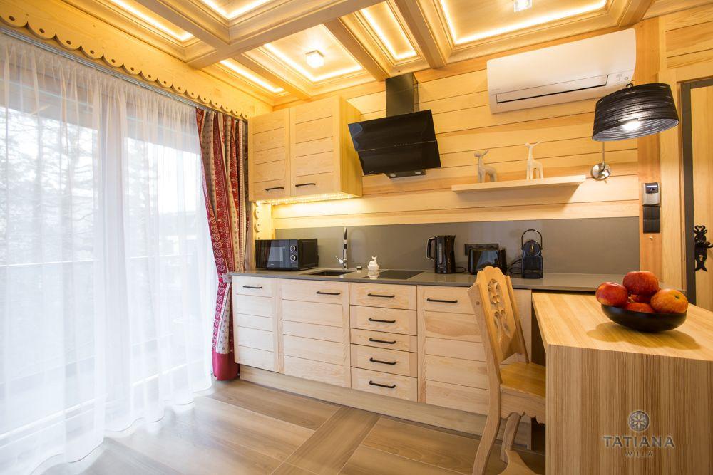 Apartament Alpejski Willa Tatiana folk drewniana kuchnia